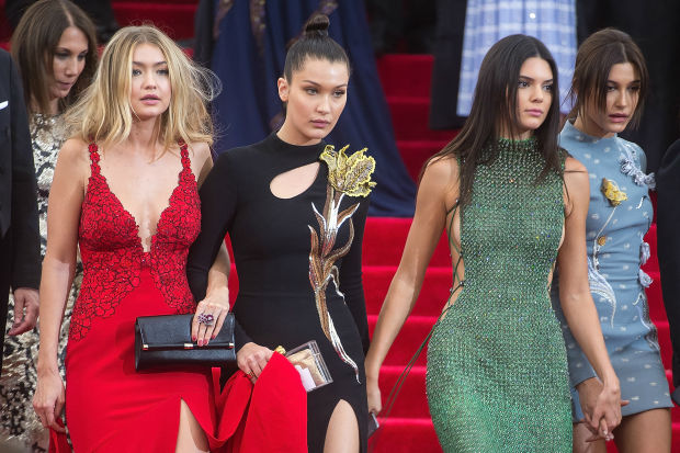 Gigi, Bella and Kendall with Hailey Baldwin at last year's Met Gala; image  via