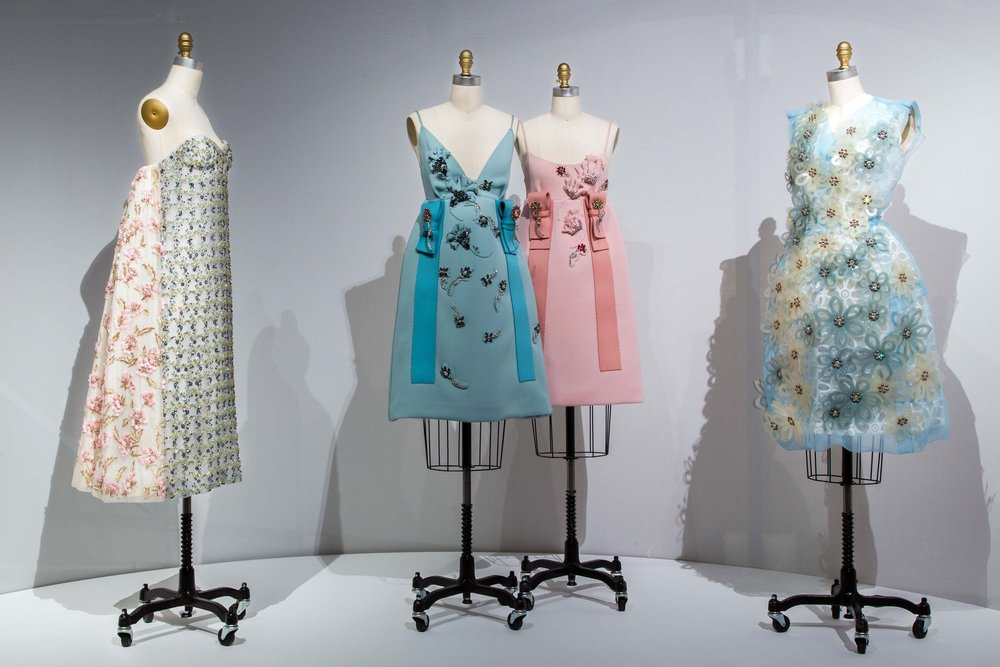 From L to R: dresses by Dior, Prada and Louis Vuitton; image  via