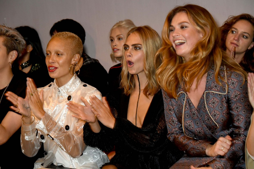 From L to R: Adwoa Aboah, Cara Delevingne and Lily James at Burberry; image via