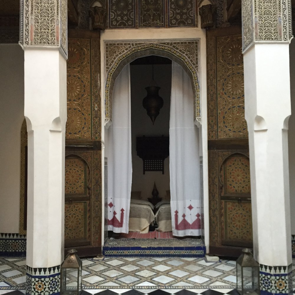 The interior of a  riad , a guest house with rooms arranged around a central courtyard.