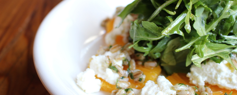 Wild Arugula Salad with naval orange, farro, hazelnuts,E.V.O.O. and house-made goats milk ricotta; image via