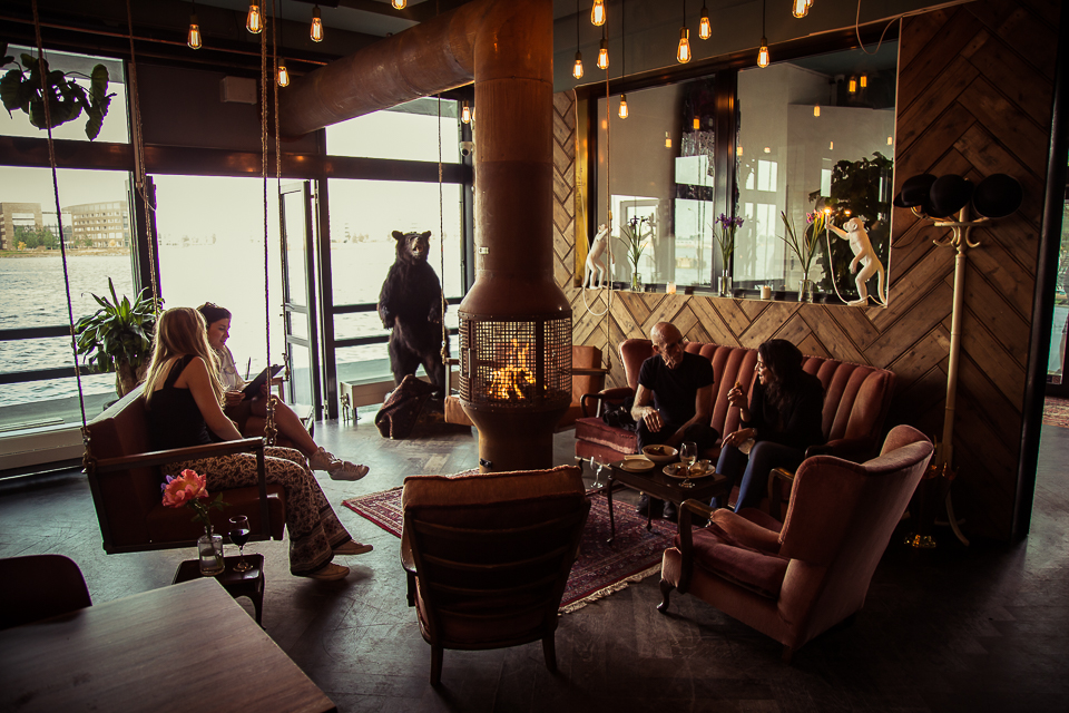 Locals enjoying Meneer Nieges' cozy interior; image  via
