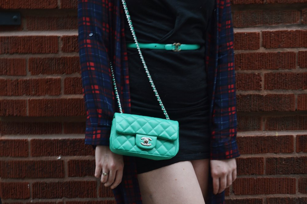 The matching belt and bag are by Chanel.