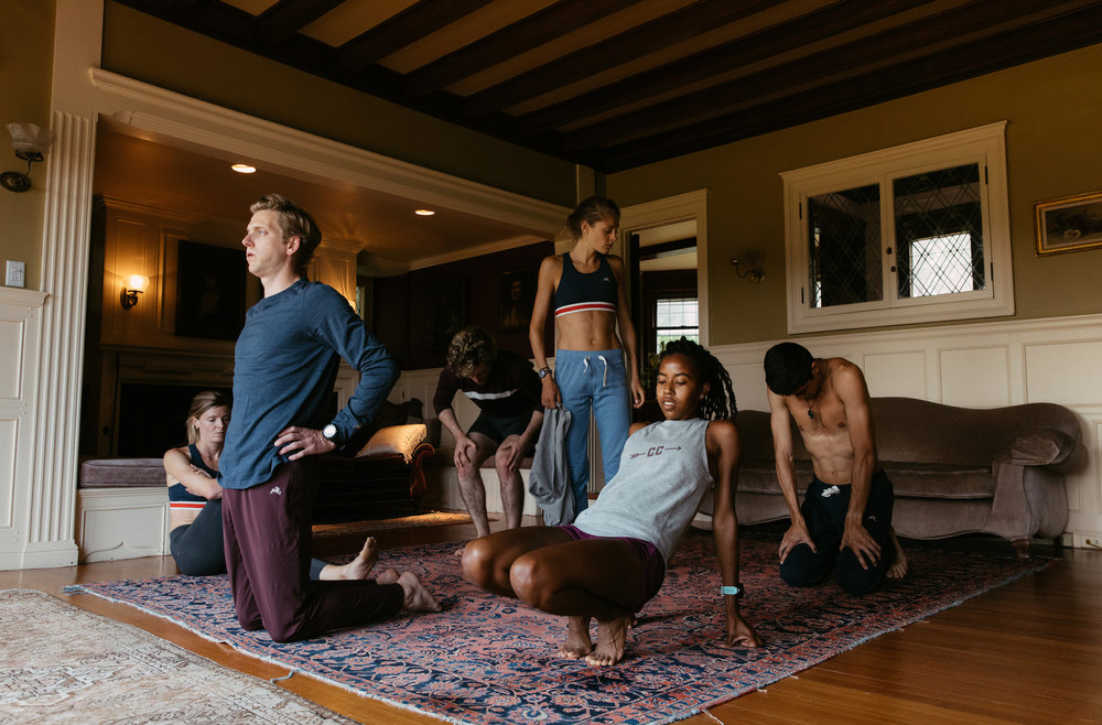 Tracksmith athletes feature the fall line as they finish a core and stretching session.