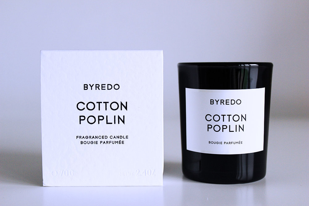 Byredo's Cotton Poplin Fragranced Candle -  A trip to Barney's New York introduced me to my new obsession with candles. Byredo's fragranced candle line has a similar vibe to Maison Margiela's Replica, evoking nuanced memories through a unique olfactory experience. Cotton Poplin is a subtle clean linen scent that reminds me of Sunday morning laundry with a warm, homelike comfort.Image Via