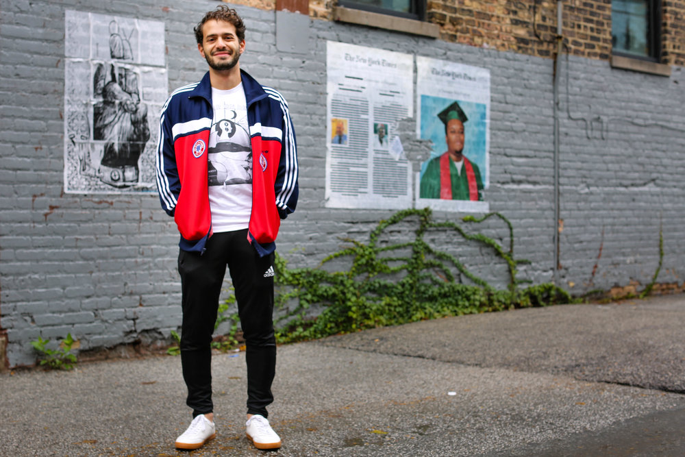 Here I'm wearing sneakers from Boohooman (cheap but really versatile), Adidas joggers, and an original 1985 Maccabi Games zip-up I thrifted in Philadelphia.