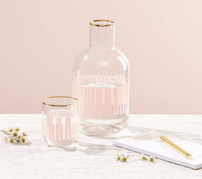 Water Carafe - Whether you're buying a gift for someone who's in housing or has their own apartment, you can't go wrong with a classy (and millennial pink!) glass carafe. It's the perfect addition to a vanity or a bedside table. And let's be real: knowing you don't have to get up to go to the kitchen when you wake up parched sure helps you rest easy.