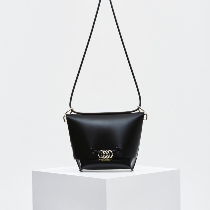THE UNITY - With a top-flap design and steel ring accents, this statement bag will top any outfit perfectly. Part of the United Collection. Shop here.
