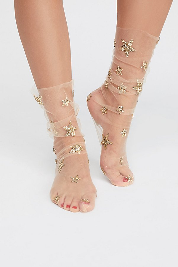 Lirika Matoshi Stars in Her Eyes Socks - I know these seem frivolous and wholly unnecessary, but where is the fun in a gift that is practical? Give the gift of glitter in this unique little stocking stuffer, which is perfect for pairing with strappy heels for a shimmery night out. Image via