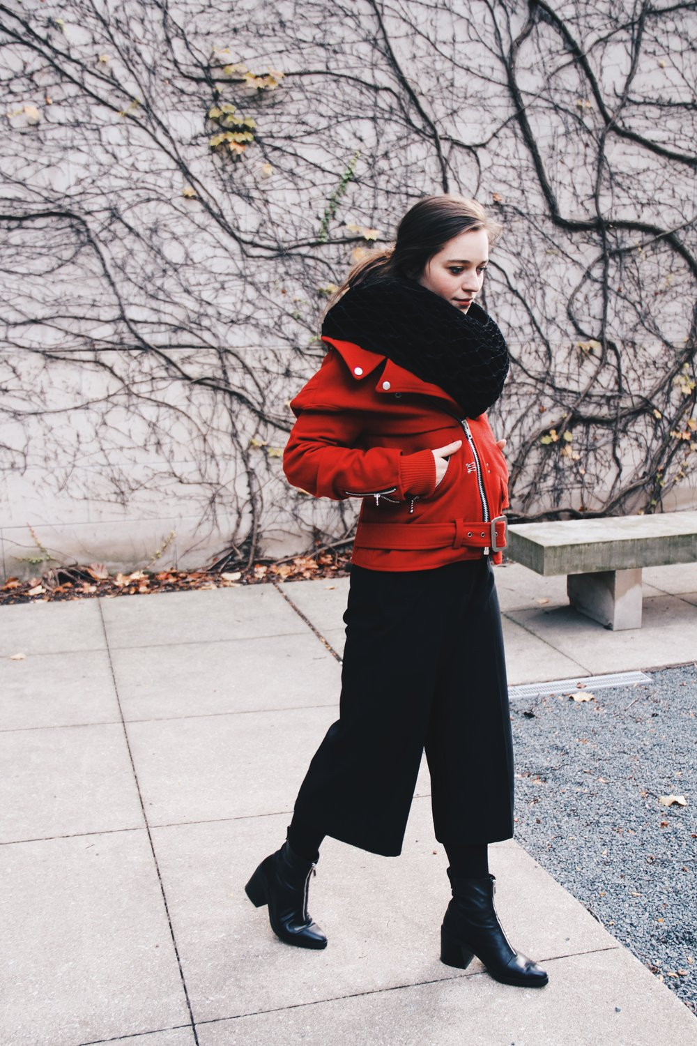I'm wearing my favorite piece, a red Junya Wantanabe coat with attached ruff scarf, my go-to Zara culots and heeled zip-up boots.