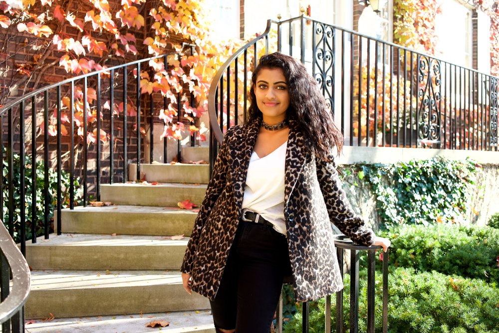 Here Yamini wears: a Leopard Print coat from Forever 21, a tank top is a dress from Amazon that she hacked off into a tank top, Chelsea rain boots from Jeffrey Campbell, and a necklace from Forever21.