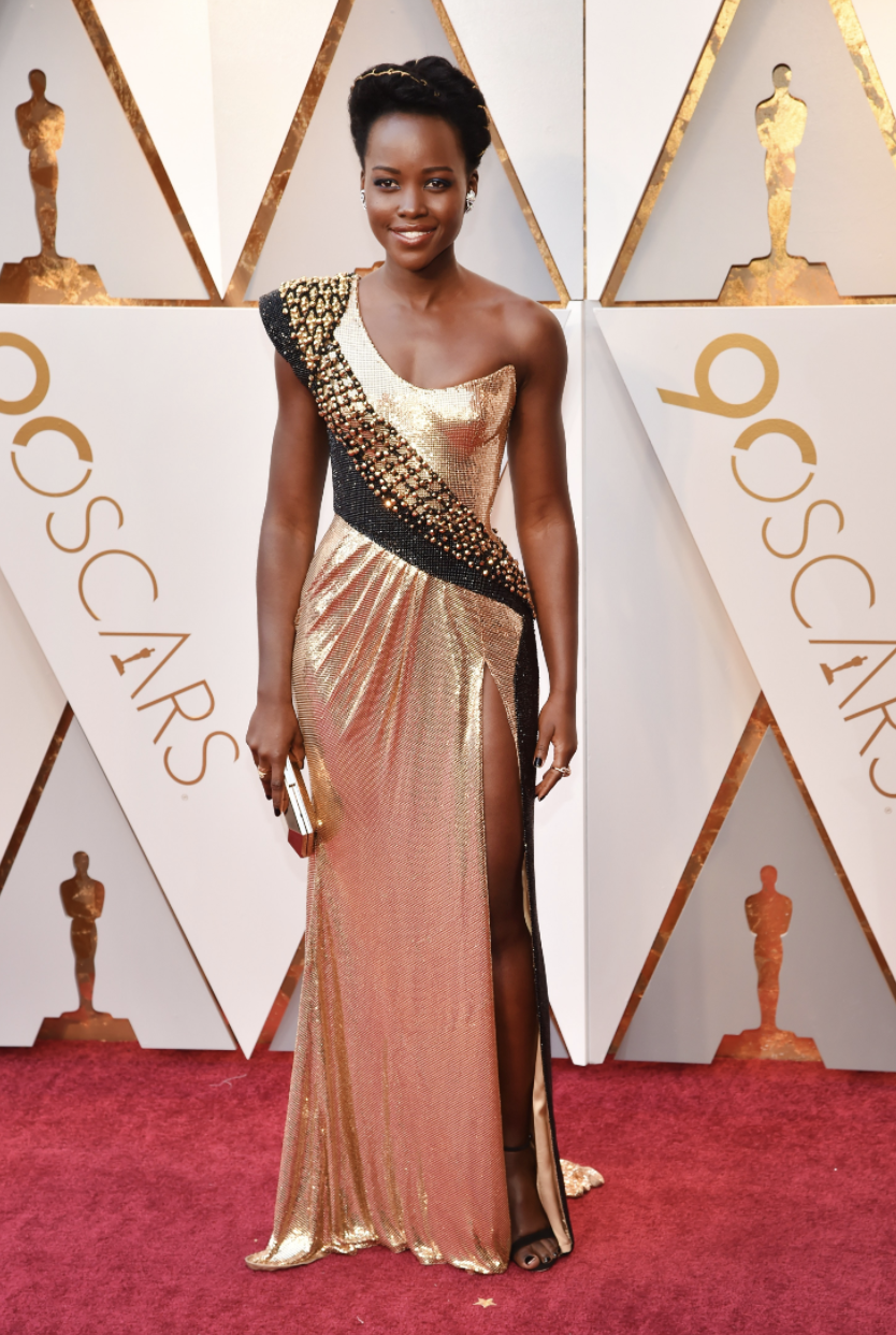 Lupita Nyong'o in custom Atelier Versace, Versace bag, Niwaka jewelry and Alexandre Birman shoes | Image  Via
