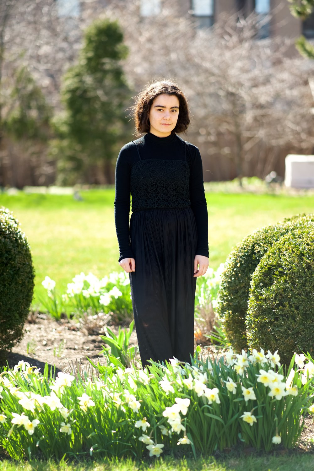 For this look, I am wearing a Worthington wool coat (thrifted), a Zara Basic ribbed mock neck long-sleeve shirt, a black lace top passed down from my mom (probably custom-made) and Uniqlo wool cropped wide-leg trousers.