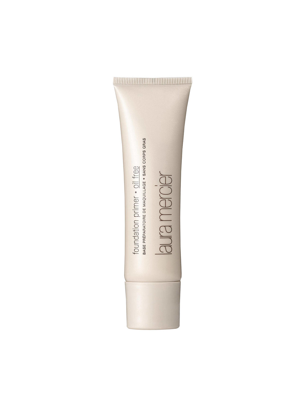 Laura Mercier Oil-Free Primer - One of my summer impulse-buys, this product finally got me into primer. Normally, I think primer is a gimmick; Benefit's Porefessional and Tarte's Poreless Primer were too much dimethicone for my liking. But this is a lightweight, gel-based, vitamin-infused primer that creates a natural and dewy complexion for foundation. On good skin days, I even opt out of foundation and wear the primer as an illuminating base.Image Via