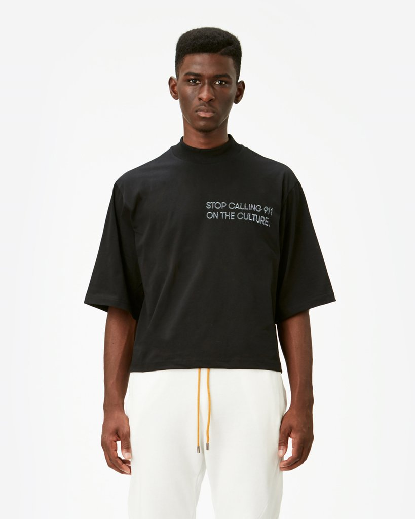"""Titled the """"911"""" Tee, this T-shirt is just one example of the many ways in which Pyer Moss speaks about policy brutality against people of color, namely African Americans.  Image    via   ."""
