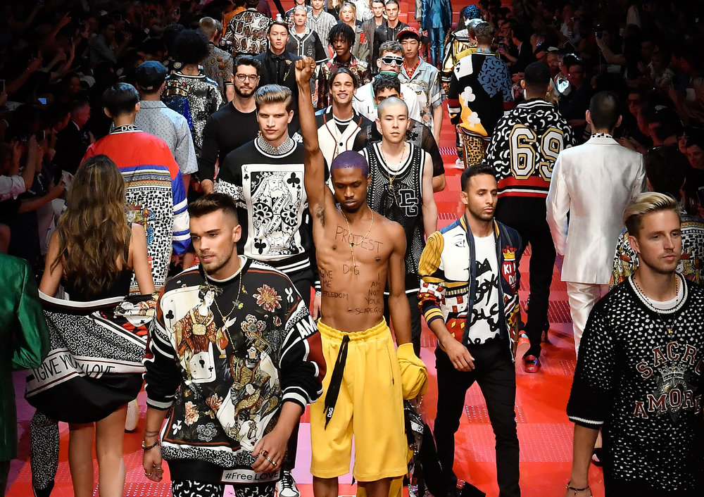Singer-Model Raury protesting the D&G show on the runway after the brand had made t-shirts mocking the nature of boycotting (after many people decided to boycott the brand).