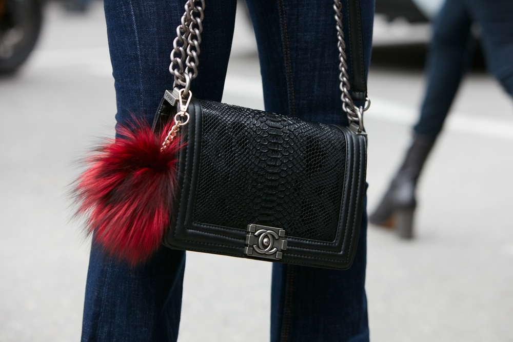 """A black Chanel python """"Boy Bag."""" Source of image can be found  via ."""