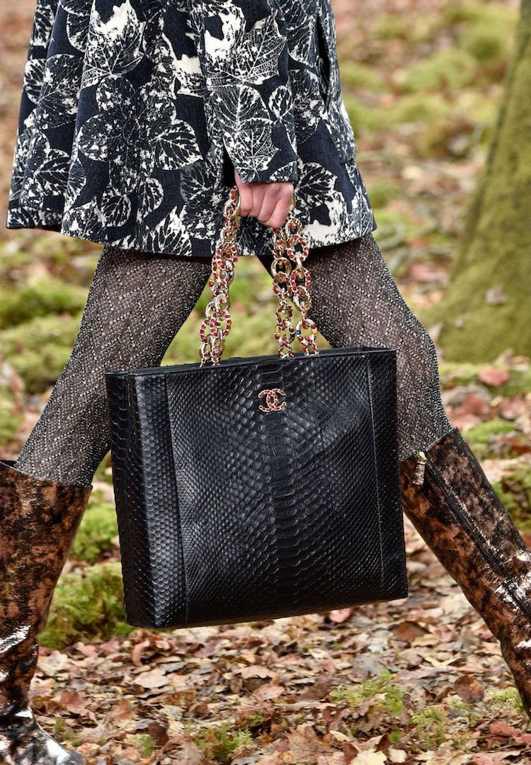 A python Chanel piece featured in Chanel's Fall 2018 runway show. Source of image can be found  via .