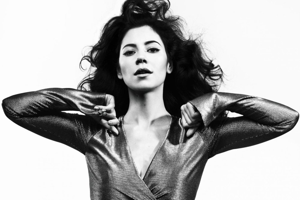 """""""Handmade Heaven,"""" MARINA - MARINA (fka Marina and the Diamonds) is officially back after a three year hiatus and the world is better for it. She has dropped part of her name and gifted us with a gorgeous single: """"Handmade Heaven,"""" in anticipation of her fourth album. Regardless of whether you spent all of 2012 and 2015 blasting her previous two albums or had never heard of her until just now, do yourself a favor and check MARINA out."""