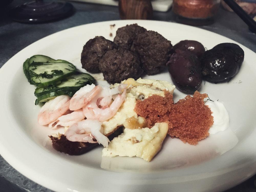 Chez Swantreras Smörgåsbord: Västerbotten souffle med räkor (shrimp) och gräddfil (sour cream) och rom (caviar); potatis med dill (potatoes w/ dill), köttbullar, and quick-pickled cucumbers.