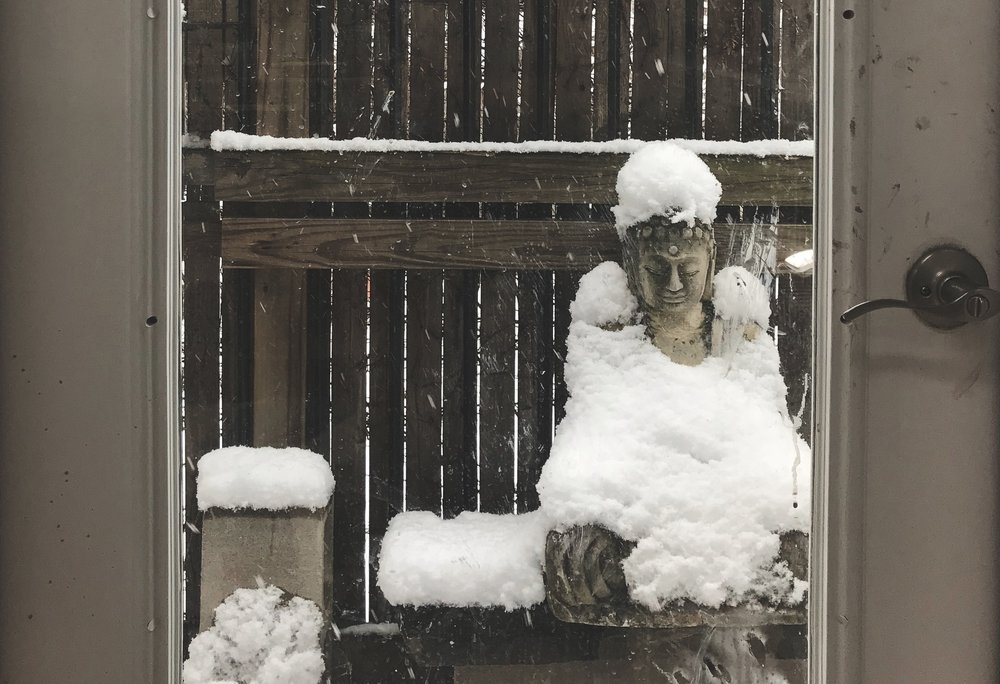 Little buddha was covered in snow today. As still and as peaceful as stone.