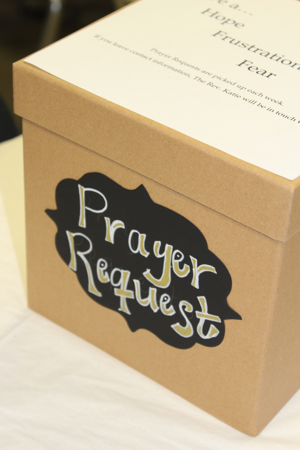 The prayer box in the teacher's lounge.  Canon. Katie collects the prayer requests each Monday.  Interested in joining the Project 33701 prayer team? Contact Canon Katie at kchurchwell@spcathedral.com