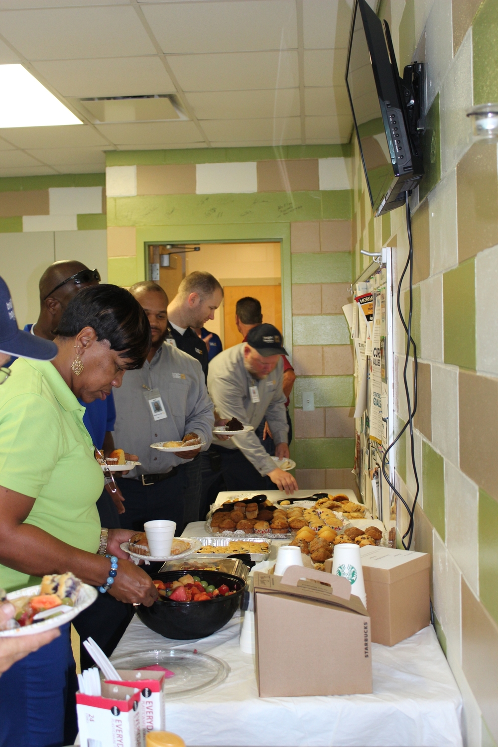 Staff and community members join together for breakfast.  There was so much food!