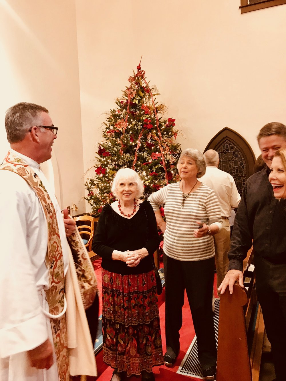 Dean Stephen Morris greets parishioners after the 10:30pm service on Christmas Eve