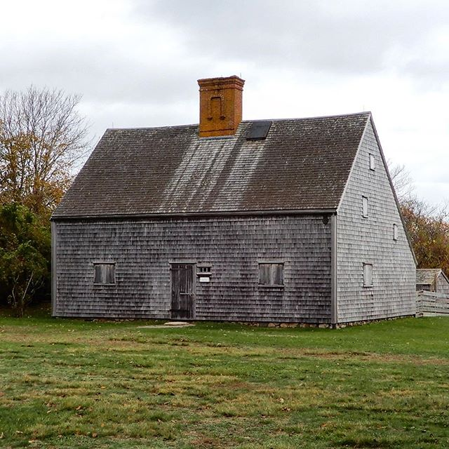 "This morning I walked over to the Jethro Coffin House, known as the ""Oldest House in Nantucket,"" it most likely being the oldest residence that still stands on its original site on the island. It dates back to about 1686 when it was built as a wedding gift for Jethro Coffin and Mary Gardner. There is a wealth of information online about this home and its restoration after it passed into the ownership of the Nantucket Historical Association in 1923. One of its most enduring quirks revolves around the brick pattern on the chimney, which has intrigued people for years. Many believe the pattern to be little more than a Jacobean-style arch featured as a decorative element, while others speculate that it represents a wishbone or horseshoe to symbolize luck or the joining of the Coffin and Gardner families through marriage. My favorite legend surrounding the chimney is the theory that the symbol was placed there as a charm to ward off witches and stop them from flying down the chimney 🔮"