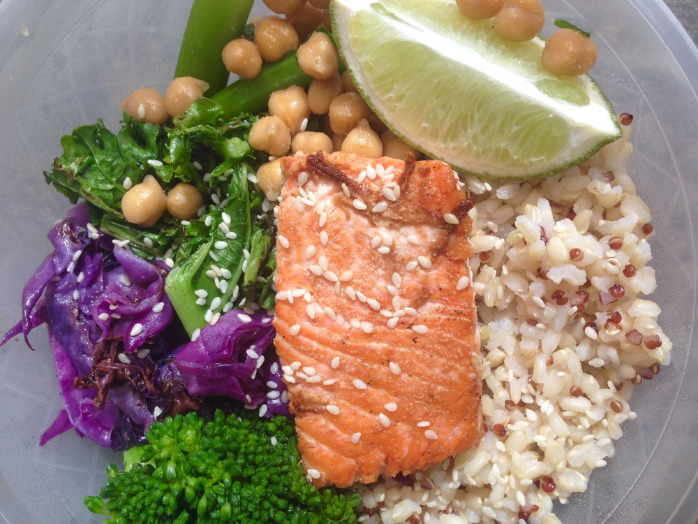 Salmon bowl with chickpeas, broccolini, quinoa, lime, cabbage, greens, sesames and green dressing