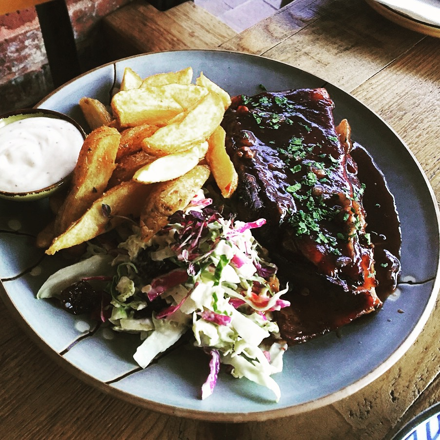 Black Cherry Smoked Beef Ribs with house made brussel sprout and raisin slaw served with horseradish aioli and hand-cut chips!
