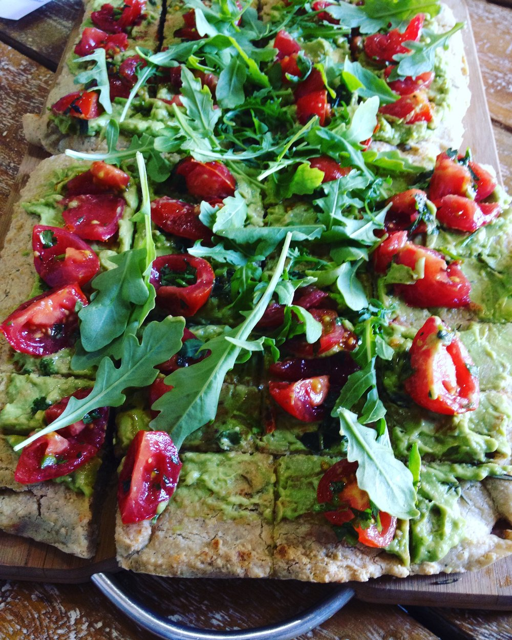 Avo smash, with rocket and tomatoes onfocaccia by GH Produce