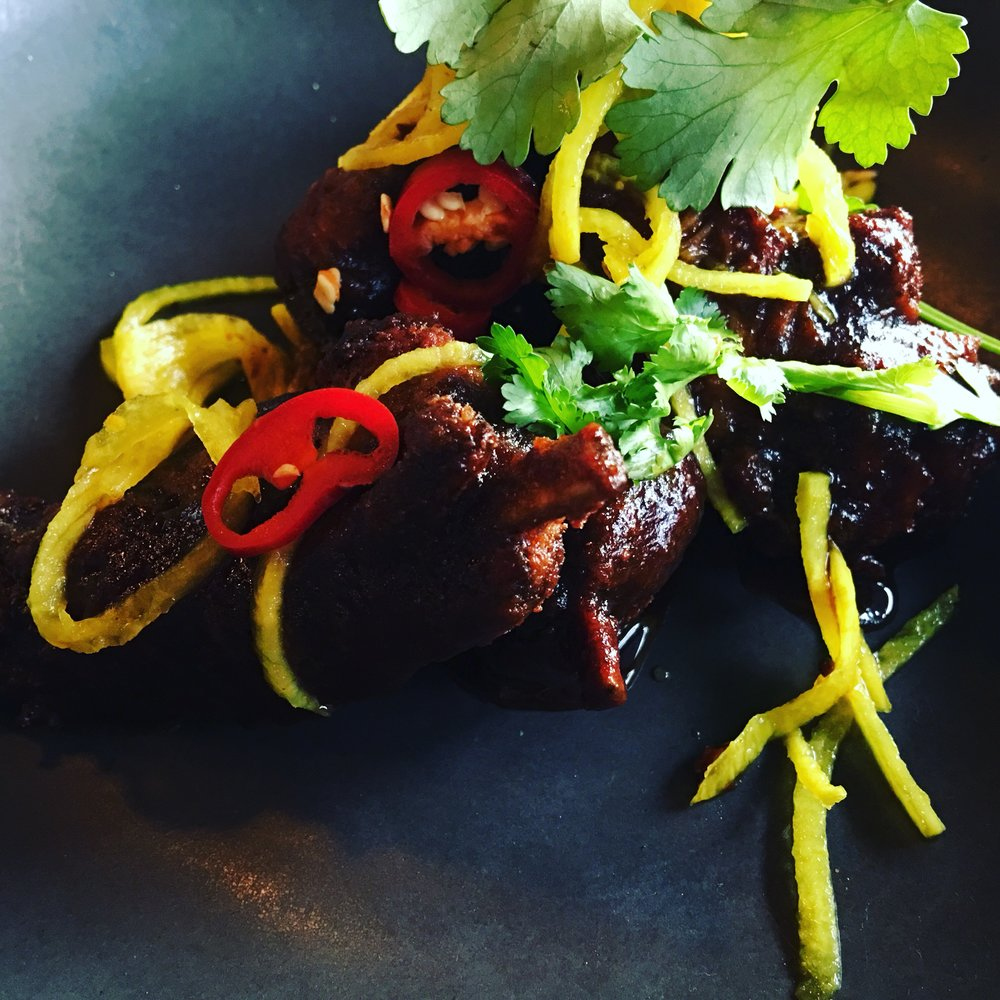 Lamb ribs, twice cooked, sweet tamarind, chilli, mint and coriander