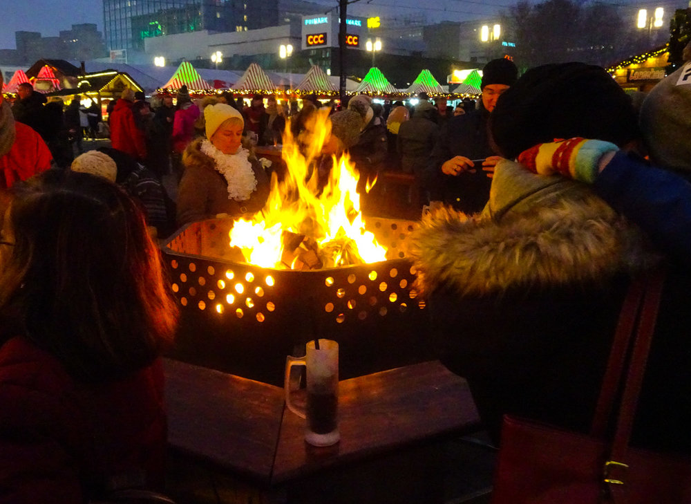 Gathering around a fire Berlin Christmas Markets   Photo:  Calvin Wood