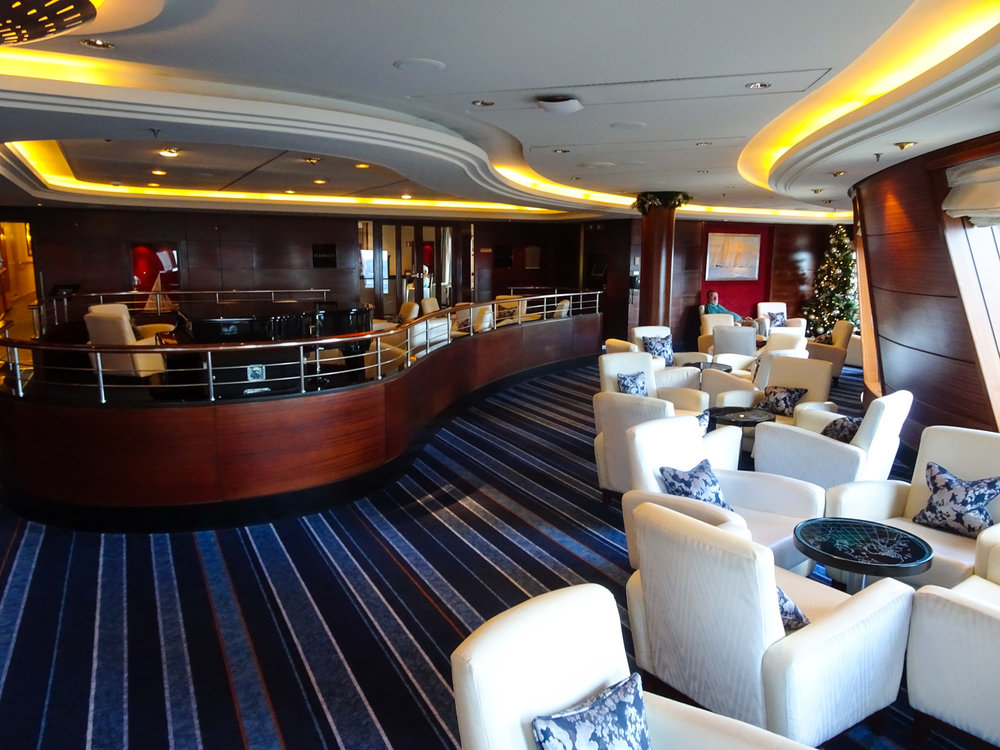The Queen Mary 2 - Seating in the Commodore Club   Photo:  Calvin Wood