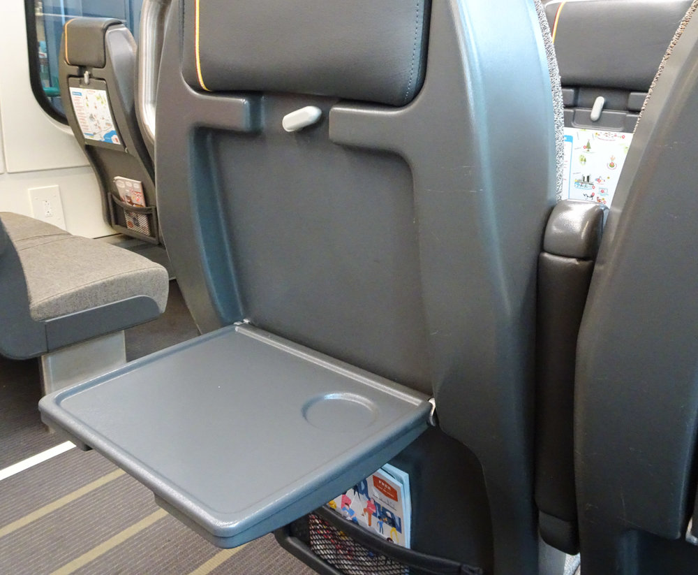 Seat Back Tables Allow You To Work - Pearson Express  Photo:  Calvin Wood