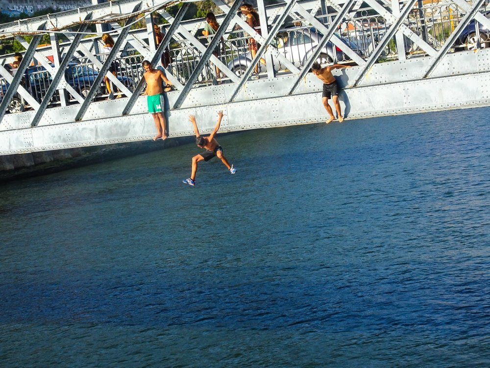 Kids Jumping off the Lower Part of the Dom Luís I Bridge   Photo:  Calvin Wood