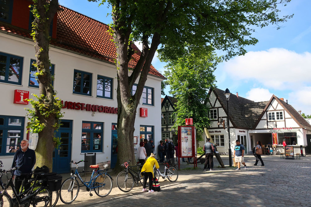 Local Shops and Tree Lined Streets - Warnemunde, Germany   Photo: Calvin Wood