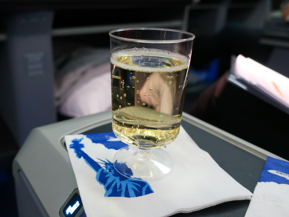 Pre-Departure Champagne - United Airlines Business Class   Photo: Calvin Wood