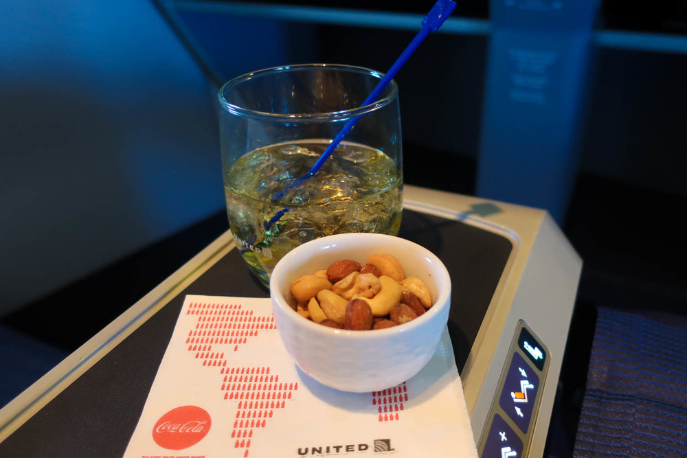 Pre-Dinner Cocktails and Warm Nuts - United Business Class - Photo: Calvin Wood
