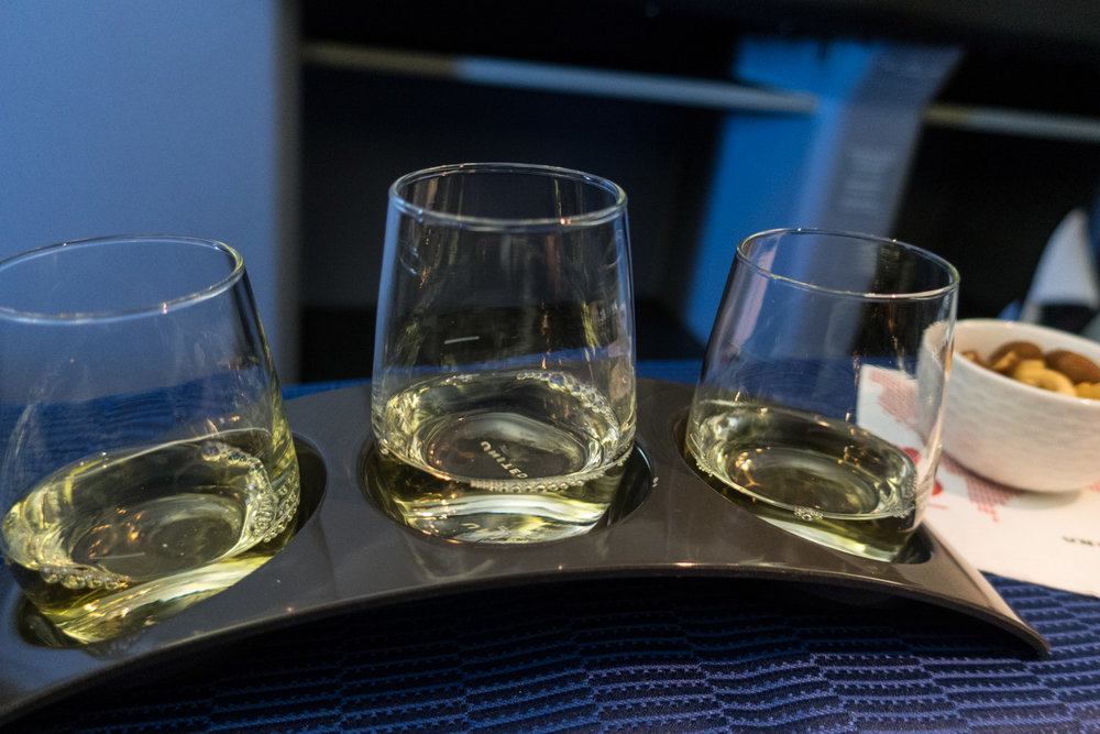Wine Tasting at 30,000 Feet!  United Business Class     Photo: Calvin Wood