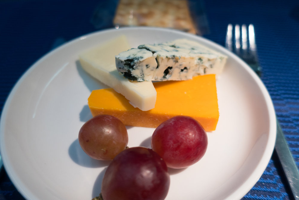 Continental Cheese Plate - United Airlines 777-200    Photo: Calvin Wood