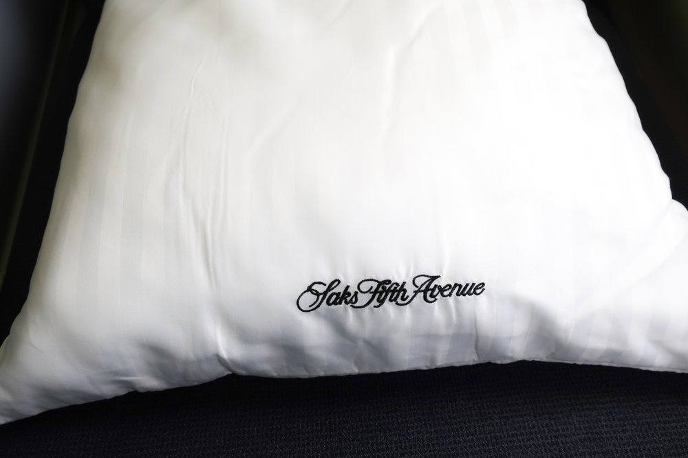 Saks Fifth Avenue Pillow - United First Class Boeing 777-200   Photo: Calvin Wood