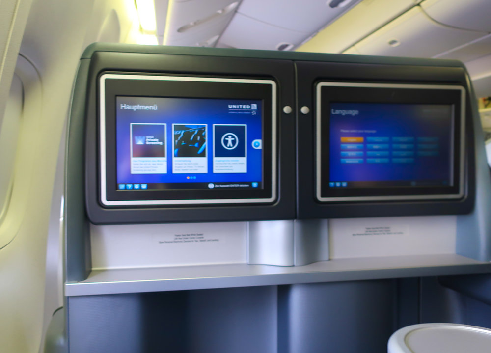 Movie Screens - United First Class Boeing 777-200   Photo: Calvin Wood