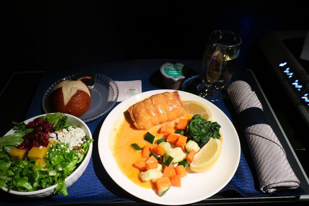 White Fish with Lobster Sauce - Domestic First Class United  Photo: Calvin Wood