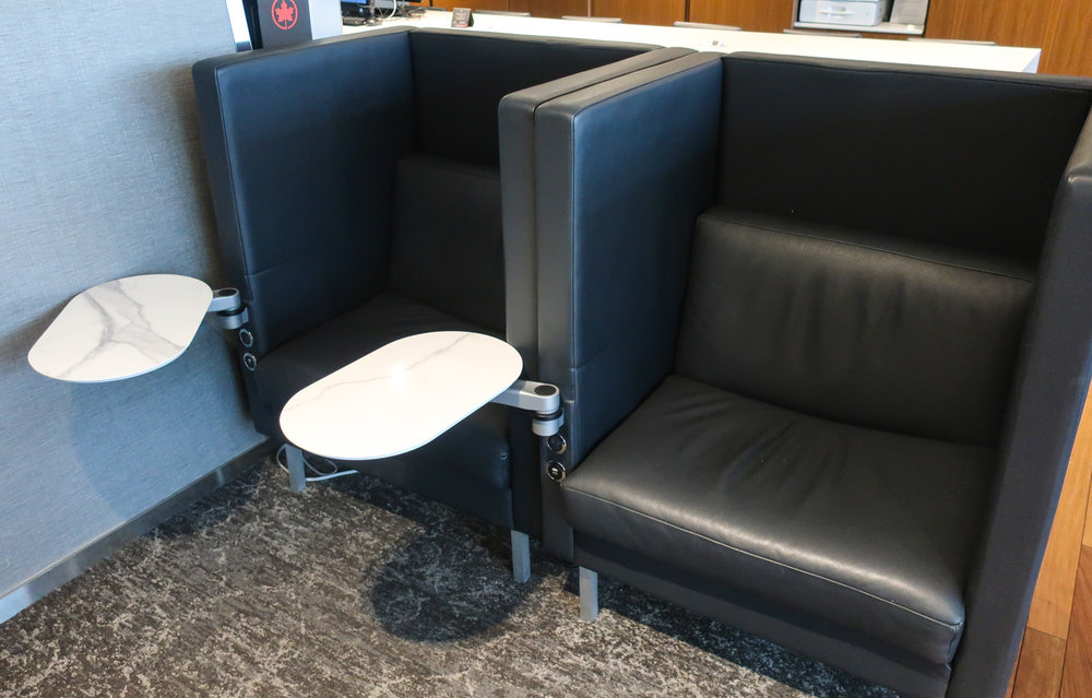 Work Seats - Air Canada Business Class Lounge - Montreal   Photo: Calvin Wood