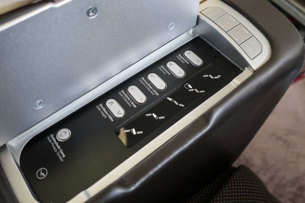 Seat Controls - LH First Class B747-800   Photo: Calvin Wood