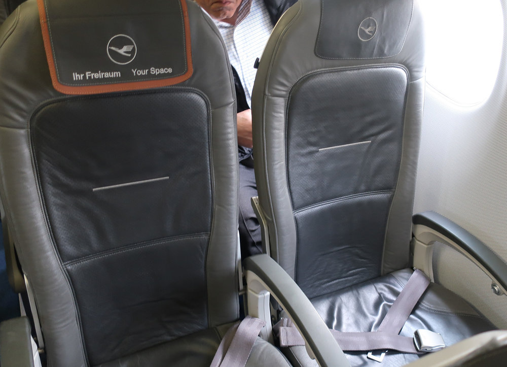 Business Class Seat - Lufthansa Embraer 90   Photo: Calvin Wood