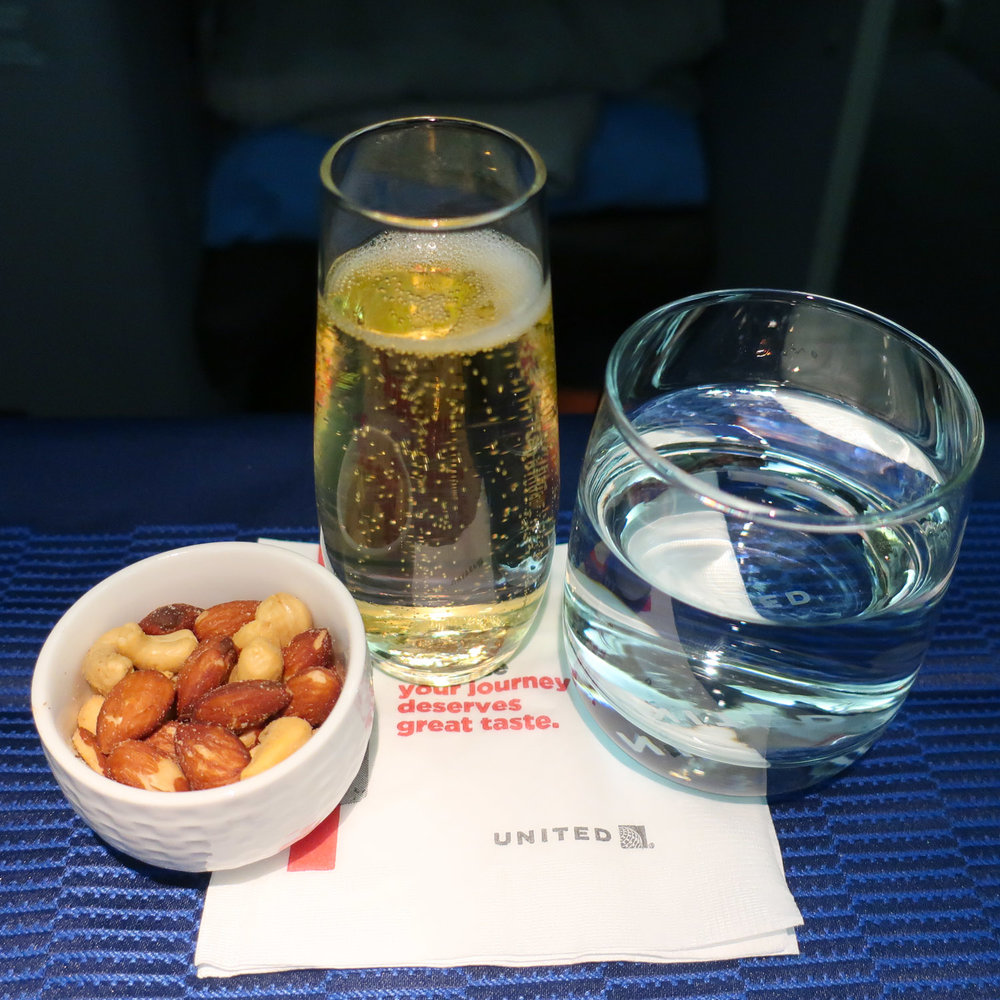 Champagne & Warm Nuts - United Airlines Business Class  Photo: Calvin Wood