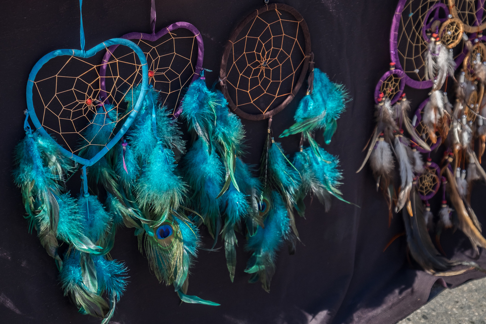 blue and purple dreamcatchers with peacock feathers
